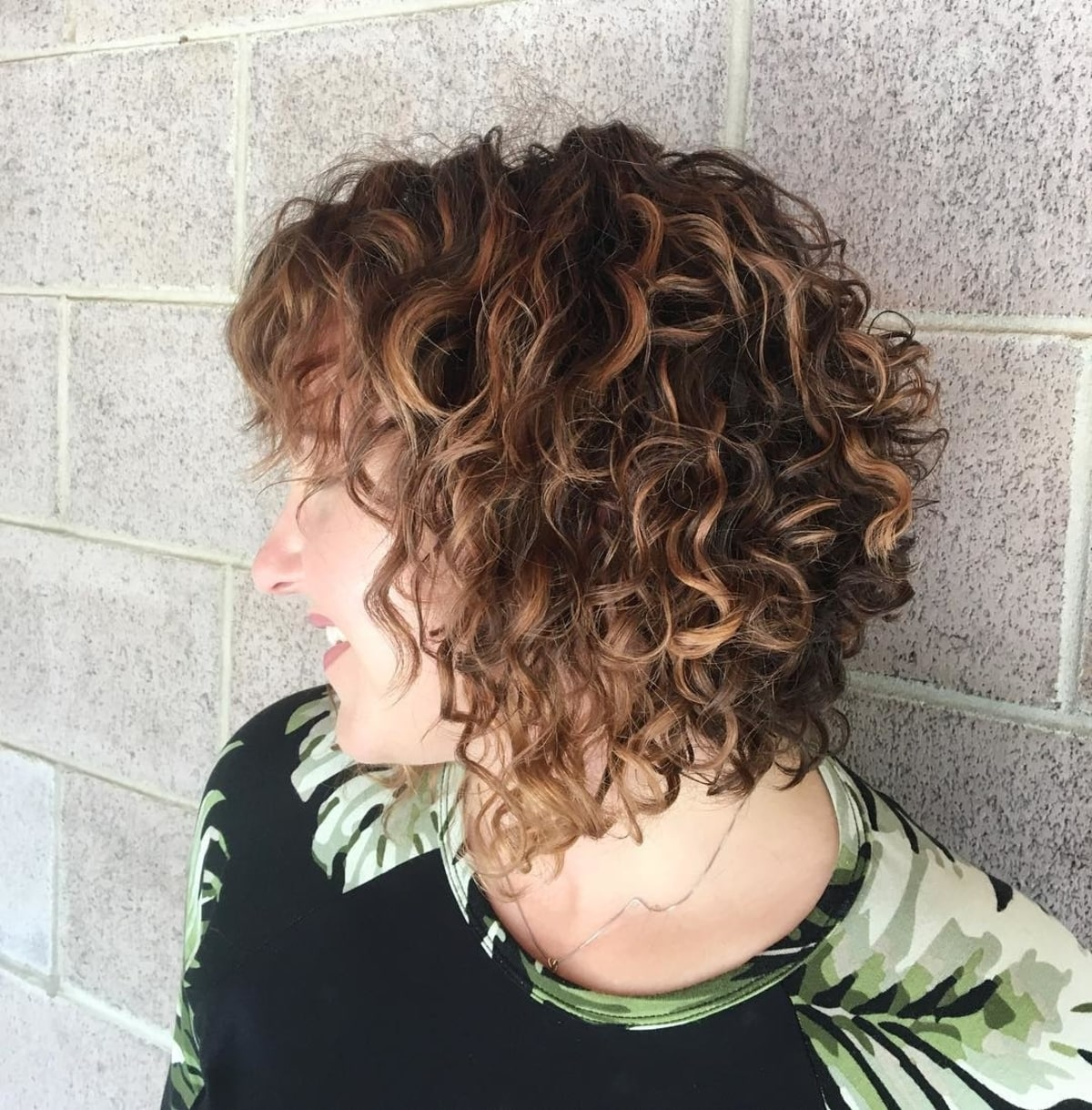 19 Best Curly Bob with Bangs for the Most Flattering Haircut & Hairstyle