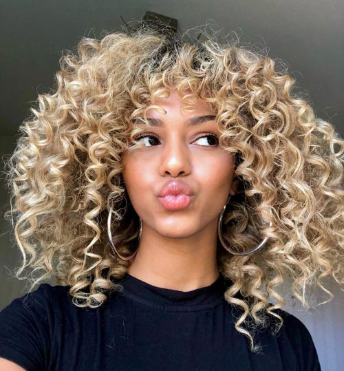 The 21 Cutest Examples of Naturally Curly Hair with Bangs