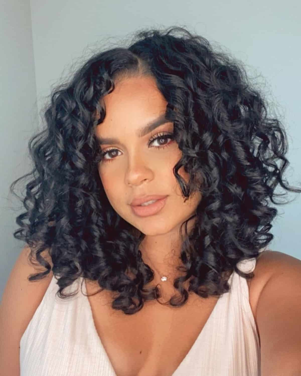 The 32 Best Shoulder Length Curly Hair Styles and Cuts