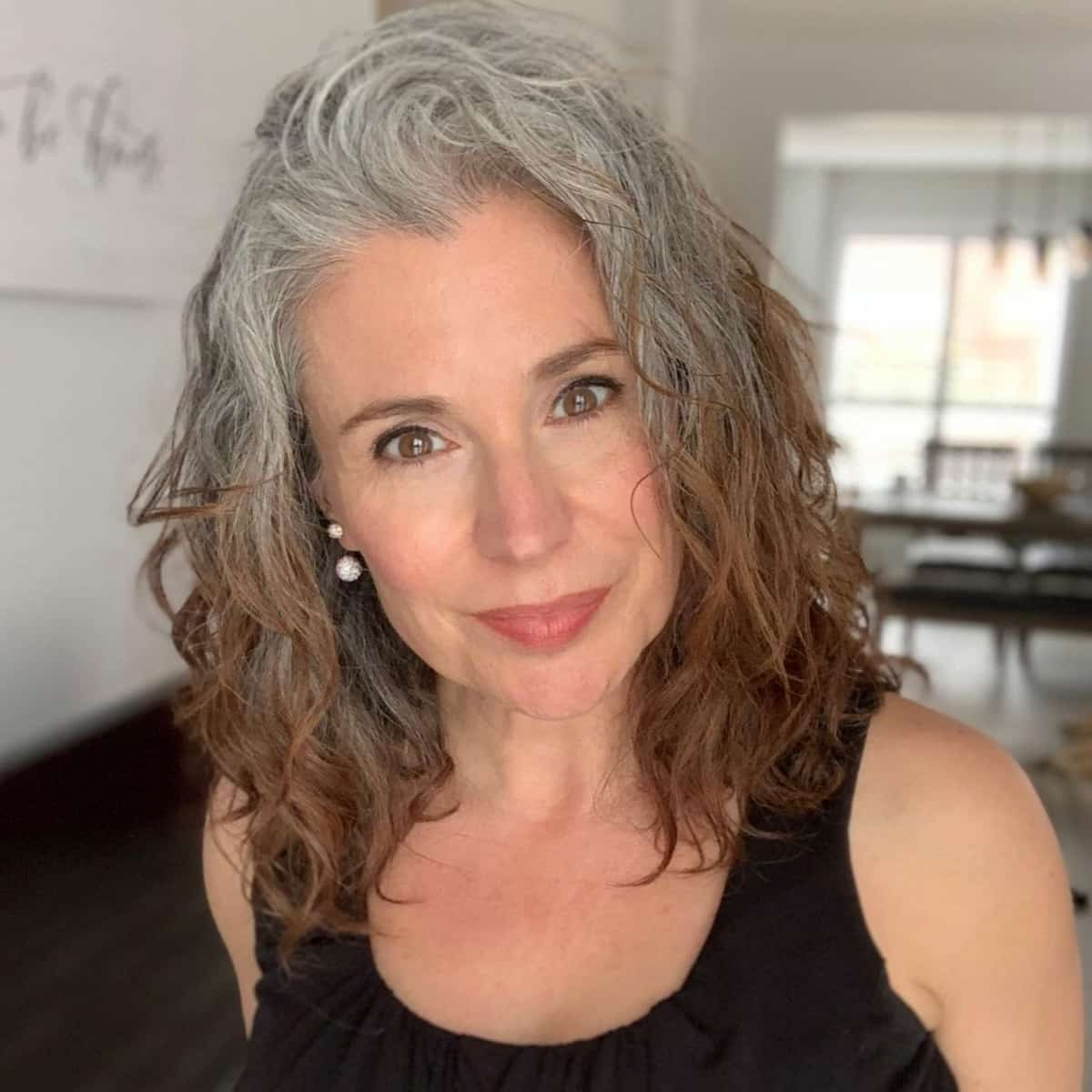 22 Best Haircuts & Hairstyles for Women Over 50 With Thick Hair